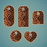 Collection of colorful tags with animal pattern imitating jaguar. Fur with  removable holes, illustration Royalty Free Stock Photo