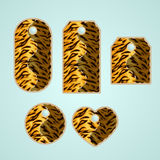 Collection of colorful tags with animal pattern imitating tiger. Fur with  removable holes, illustration Stock Photography