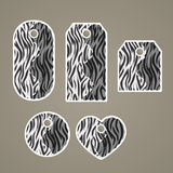 Collection of colorful tags with animal pattern imitating zebra. Fur with  removable holes, illustration Stock Photo