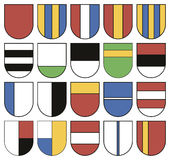Collection of colorful templates for coats of arms. Set of twenty different shields. vector illustration