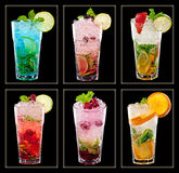 Collection of colorful tropical cocktails. Isolated on black background Stock Images