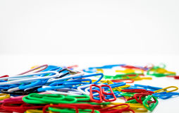 A Collection of  Coloured Paper Clips. A collection of bright coloured paper clips  isolated on a white background Stock Image