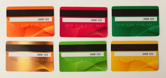Collection of colourful credit cards isolated. On white background. Finance, well-being, modern payment systems, online shopping concept, top view Stock Images