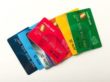 Collection of colourful credit cards isolated. On white background. Finance, well-being, modern payment systems, online shopping concept, top view Stock Photos