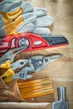 Collection of construction tooling in leather building belt on w Royalty Free Stock Photo