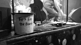 Tips bucket on concert stage royalty free stock photo
