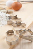 Collection of Cookie cutter forms with flour Royalty Free Stock Photos