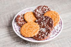 Collection of cookies - vanilla flower shaped cookies, cookies dipped in milk chocolate and sprinkled with freshly shredded coconu stock images