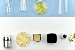 Collection of cosmetic bottle containers and laboratory glassware, Blank label for branding mock-up. Collection of cosmetic bottle containers and laboratory stock image