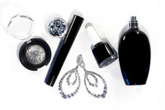 Collection with cosmetics tools. Fashion evening decorative set with make-up accessories, black nail polish, silver eyeshadows, ma Stock Images