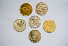 A collection of cryptocurrency coins royalty free stock photo