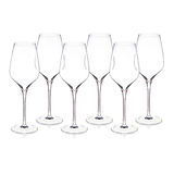 Collection of crystal wine glasses arranged on white surface. Royalty Free Stock Photography