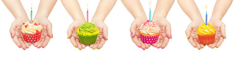 Collection of cupcakes in hand Stock Images