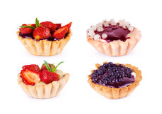 Collection of cupcakes with strawberry, currant, mint and jam on. Collection of cupcakes, with strawberry, currant, mint and jam on white background Stock Images
