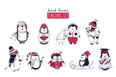 Collection of cute penguins wearing different winter clothing and hats isolated on white background. Set of cartoon Royalty Free Stock Images