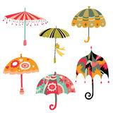 Collection of Cute Umbrellas. Lots of cute umbrellas with different shapes and colors Stock Images
