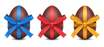 Collection of 3D chocolate Easter eggs with colorful ribbon bows Stock Images