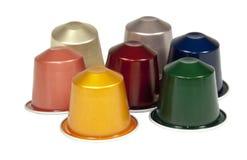 Collection d'isolement de cosses colorées de café sur le blanc Photos libres de droits