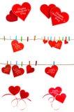 Collection de coeur rouge mignon accrochant sur la corde à linge Image stock