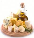 Collection de fromages et d'huile d'olive Photographie stock libre de droits