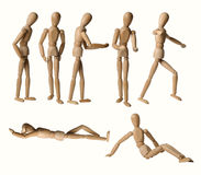 Collection de mannequins en bois d'isolement à l'arrière-plan blanc Images stock