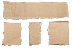 Collection de morceaux bruns déchirés de carton image stock