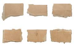 Collection de morceaux bruns déchirés de carton, aucune ombres photographie stock