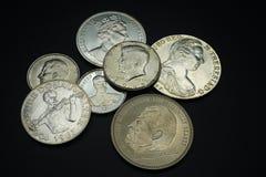 Collection de pièces de monnaie de différents pays ; L'Autriche, Allemagne, Amérique, Angleterre images stock