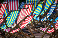 A collection of deckchairs. A collection of colorful deckchairs at Victoria Embankment Bandstand in London Royalty Free Stock Photo