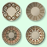 Collection of decorative ceramic dishes with ancient ornament. Stock Photography