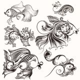 Collection of decorative elements  fish and flourishes Royalty Free Stock Images