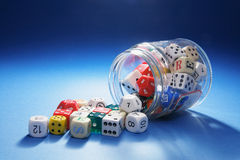 Collection of Dice in Glass Jar Stock Image