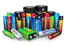 Collection of different batteries. Group of different size color batteries isolated on white background with reflection effect Stock Images