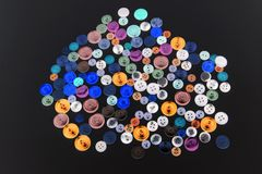 Collection of different buttons for clothes repair. Abstraction. royalty free stock image