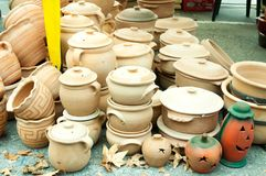 Collection of different clay cookware on the street market. Royalty Free Stock Images