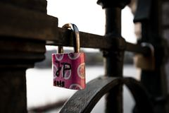 Love Locks hung along Pragues Vltava river - next to the Charles Bridge - Czech Republic - April 2019 royalty free stock photography