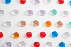 A collection of different faceted stones on a white background Royalty Free Stock Photography