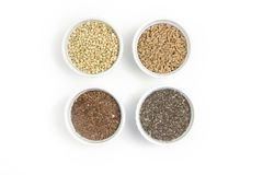 Collection of different groats on white background. Top view of buckwheat, chia, flax, amaranth, lentils, couscous stock photos