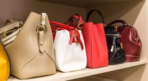 Collection of different handbags in woman closet. Collection of handbags in woman big closet royalty free stock image