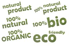 Collection of different keywordslike eco friendly, 100 % bio or 100 % organic - cut out of a green leaf royalty free stock image
