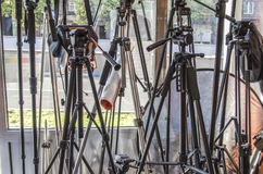 Collection of different tripods for cameras. And reflector by the window Royalty Free Stock Image