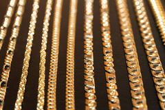 Golden chains focus Royalty Free Stock Images