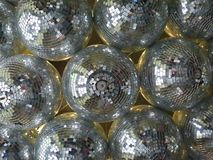 Collection of disco mirror balls hanging on a ceiling royalty free stock images