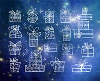 Collection of doodle sketch christmas gift boxes on blue night glowing background.  Stock Photo