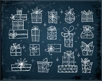 Collection of doodle sketch christmas gift boxes. On dark blue background Royalty Free Stock Photography