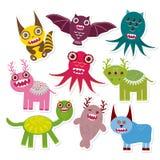 Collection drôle réglée de monstres d'autocollant illustration stock