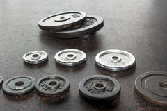 Collection of dumbbell weight plates Royalty Free Stock Images