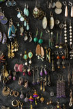 Collection of ear-rings. Ear-rings as decoration and unusual storage method Royalty Free Stock Images