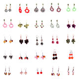 Collection of ear rings on white background. Collection of ear rings isolated on white background Royalty Free Stock Image