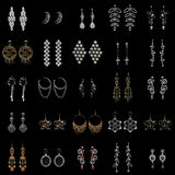 Collection of earrings on black background royalty free stock photo
